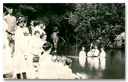 C. B. Jernigan administers baptism